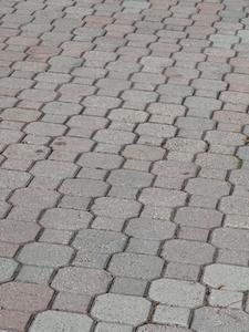 Comment poser des pavés sur un patio en béton existant